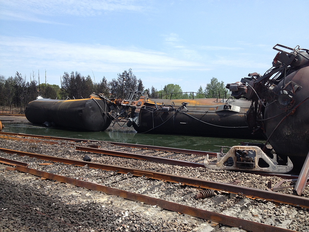 Tank cars lying on their side at Lac-Mégantic accident site