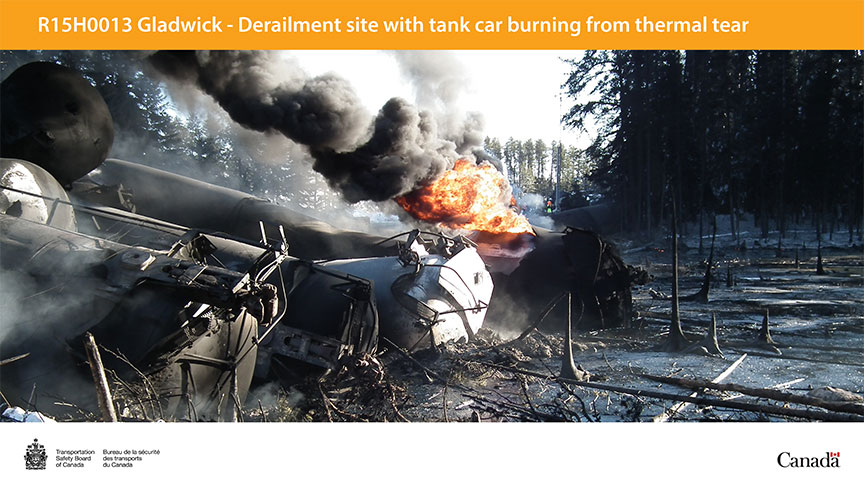 Derailment site with tank car burning from thermal tear