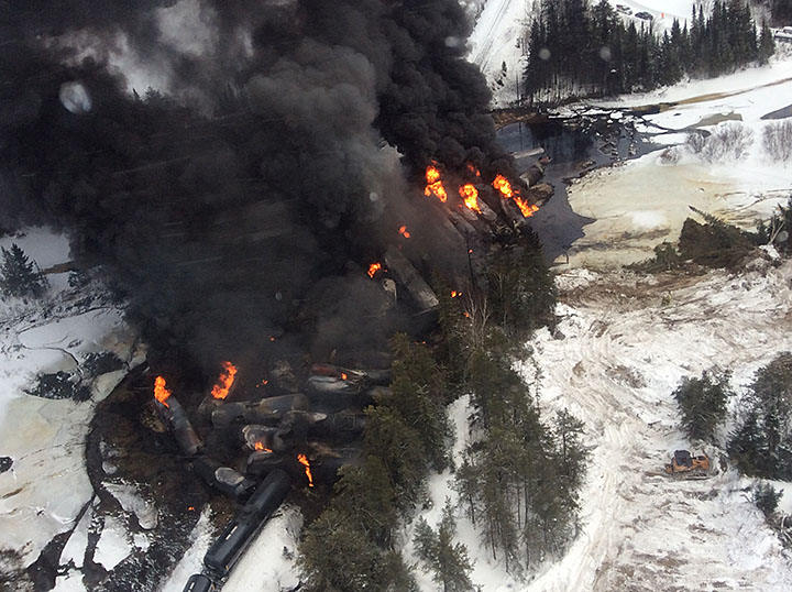 Close up overhead view of derailed ruptured tank cars on fire (March 7, 2015)